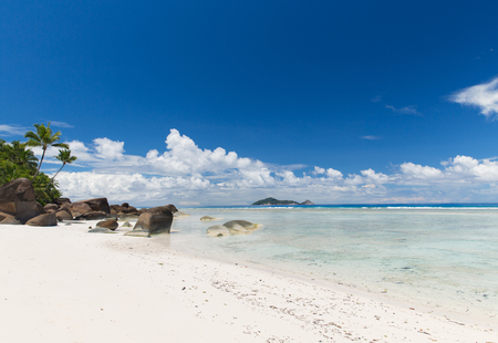 travel, seascape and nature concept - island beach in indian ocean on seychelles Фото со стока