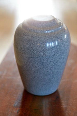 cremation urn on table