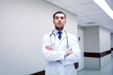 doctor with stethoscope at hospital corridor Stock Photo