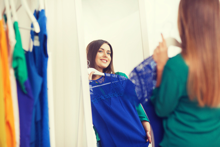 happy woman choosing clothes at home wardrobe Stock Photo