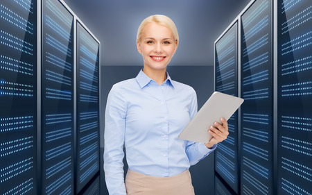 business, people and technology concept - happy smiling businesswoman holding tablet pc computer over futuristic server room background