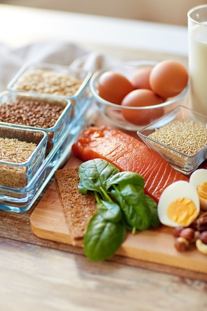 healthy eating and diet concept - close up of natural rich in protein food on table Stock Photo