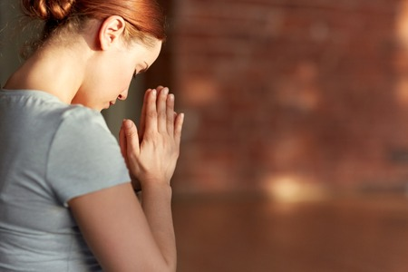 close up of woman meditating at yoga studio
