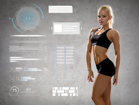 woman in sportswear posing and showing muscles Banco de Imagens