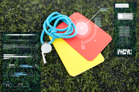 whistle and caution cards on football field Stok Fotoğraf - 81458904