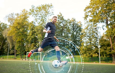 soccer player playing with ball on football field Reklamní fotografie - 81458915