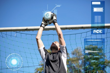 goalkeeper with ball at football goal on field Фото со стока