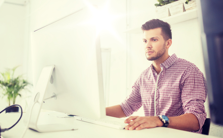 creative man or student with computer at office