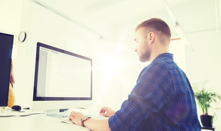 creative man or programmer with computer at office