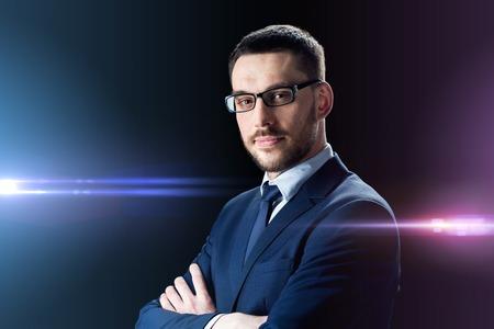 businessman in glasses over black