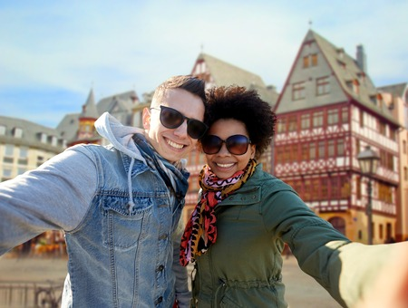 happy couple taking selfie in frankfurt city