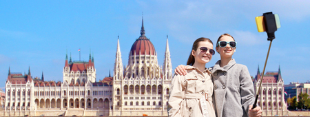 girls with smartphone selfie stick in budapest