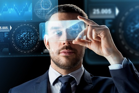 businessman with smartphone and virtual holograms Reklamní fotografie