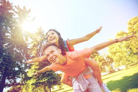 happy teenage couple having fun at summer park Reklamní fotografie