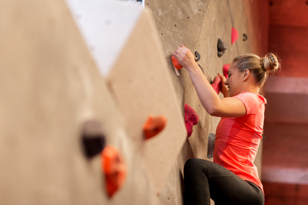 young woman exercising at indoor climbing gym Stock Photo - 81599025