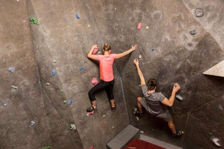 man and woman exercising at indoor climbing gym Stock Photo - 81599045