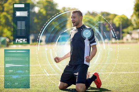 happy soccer player with ball on football field Reklamní fotografie - 81599081