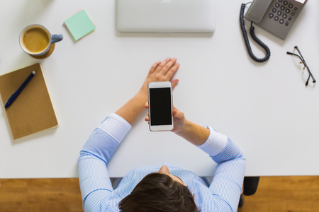 businesswoman with smartphone working at office