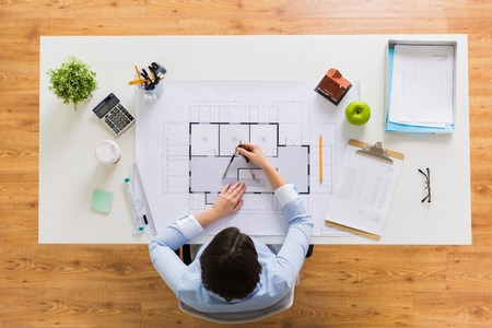 architect with compass measuring blueprint Stockfoto