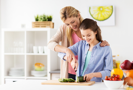 happy family cooking dinner at home kitchen
