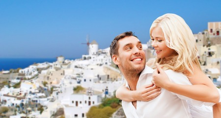 happy couple hugging over santorini island Stock Photo