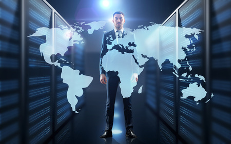 businessman with world map projection in corridor