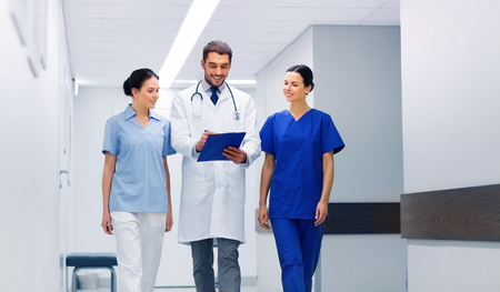 group of medics at hospital with clipboard Stock Photo