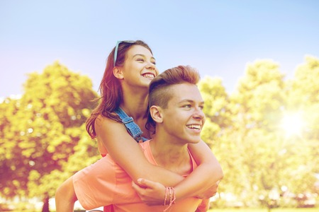 happy teenage couple having fun at summer park Imagens - 81768048