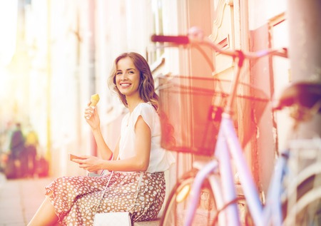 happy woman with smartphone, bike and ice cream Reklamní fotografie