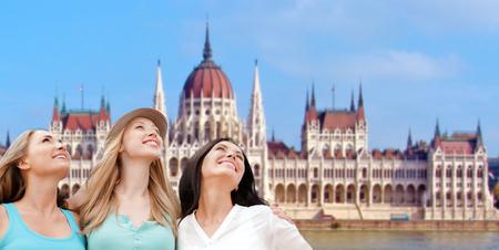happy women over house of parliament in budapest photo