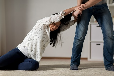 unhappy woman suffering from home violence