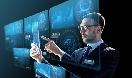 business, augmented reality and future technology concept - businessman in glasses working with transparent tablet pc computer and virtual screens projections over black background