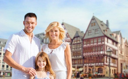 tourism, travel and people concept - happy family over frankfurt am main city background