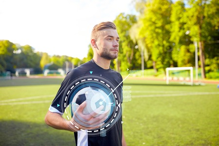 sport, football training and people - soccer player with ball on field Reklamní fotografie