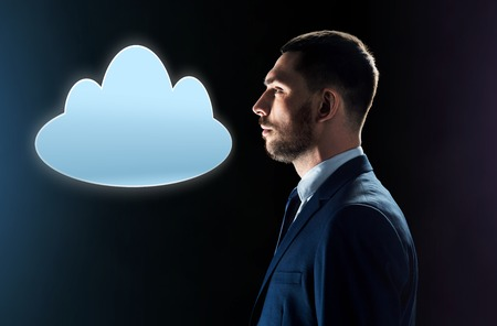 businessman in suit looking at cloud projection