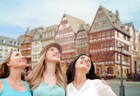 happy women over frankfurt am main background