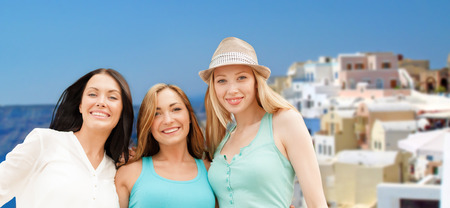 happy women over santorini island background photo