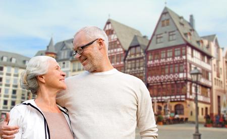 senior couple hugging over frankfurt background