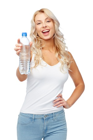 healthy eating, diet and people concept - happy beautiful young woman holding bottle of water