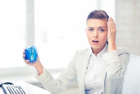 스트레스를 된 사업가 지주 시계 스톡 콘텐츠