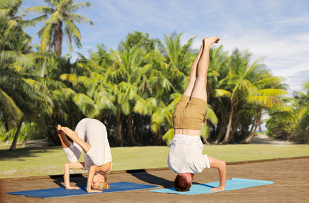 couple making yoga outdoors