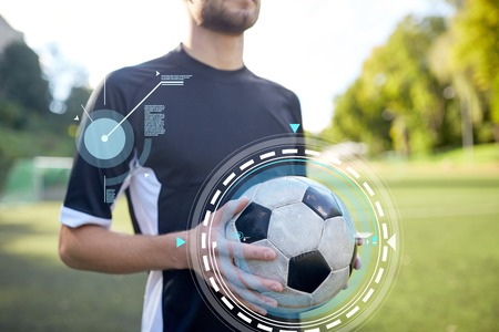 close up of soccer player with football on field Reklamní fotografie - 82430234