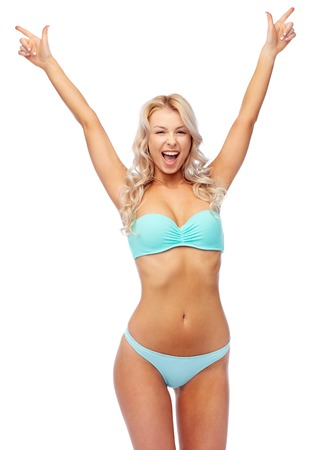 happy young woman in bikini with raised hands