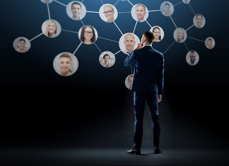 businessman with virtual corporate network photo