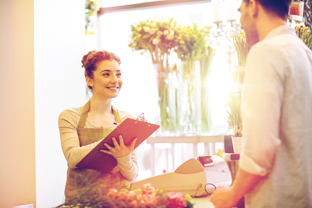 florist woman and man making order at flower shop