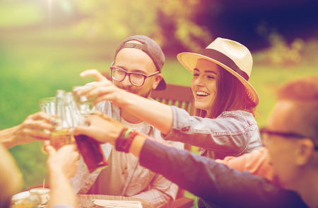happy friends clinking glasses at summer garden Stock Photo - 82489090