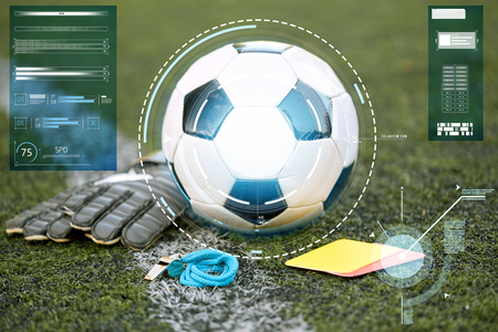 ball, gloves, whistle and cards on soccer field Stok Fotoğraf
