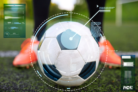 soccer player with ball on football field Stok Fotoğraf
