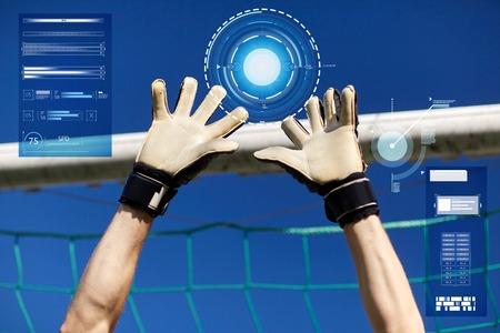 goalkeeper or soccer player hands at football goal