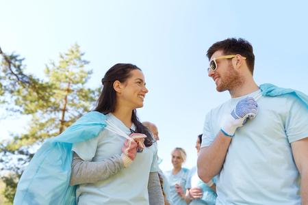 volunteers with garbage bags talking outdoors